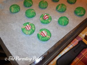 Putting the Candy Cane Kisses on the Candy Cane Blossom Cookies