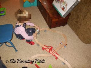 Playing with the Wooden Toy Train Set from Cubbie Lee Toy Company 2