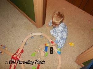 Playing with the Wooden Toy Train Set from Cubbie Lee Toy Company 3