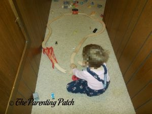 Playing with the Wooden Toy Train Set from Cubbie Lee Toy Company 1