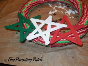 Gluing the Stars to the Duct Tape Christmas Wreath Craft