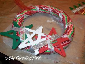 Wrapping Christmas Ribbon Around the Duct Tape Christmas Wreath Craft