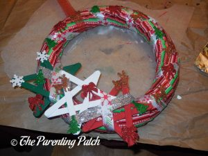 Gluing Foam Christmas Stickers to the Duct Tape Christmas Wreath Craft