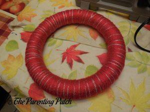 Wrapping Yarn Around Christmas Ribbon and Yarn Wreath Craft