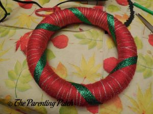 Wrapping Ribbon Around Christmas Ribbon and Yarn Wreath Craft