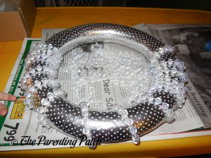 Wrapping the Beads Around the Winter Snowflake Wreath Craft