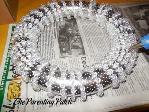 Gluing the Bead Strand to the Winter Snowflake Wreath Craft