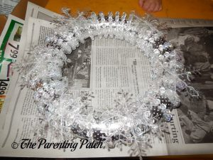 Gluing Plastic Snowflakes to the Winter Snowflake Wreath Craft
