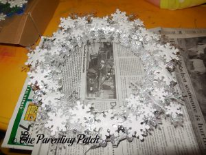 Gluing Foam Glitter Snowflake Stickers to the Winter Snowflake Wreath Craft