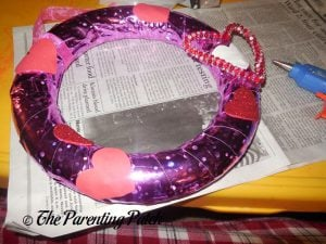 Gluing Foam Hearts to the Duct Tape Valentine's Day Wreath Craft
