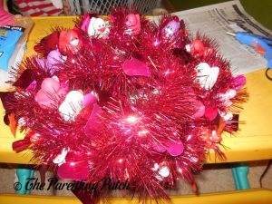 Wrapping the Garland Around the Valentine's Day Duck-oration Wreath