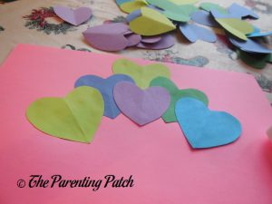 Gluing Hearts for the Heart Peacock Valentine's Day Craft