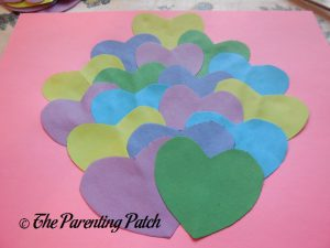 Gluing More Hearts for the Heart Peacock Valentine's Day Craft