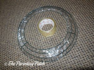 Wrapping the Wire Wreath with Clear Tape