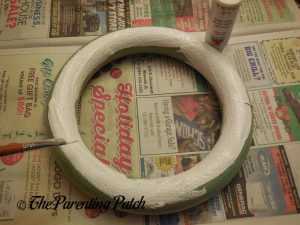 Painting the Foam Wreath for the Washi Tape Valentine's Day Wreath Craft