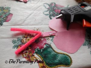 Gluing the Pipe Cleaner on the Love Bug Valentine's Day Craft