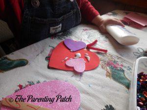 Decorating the Love Bug Valentine's Day Craft 1