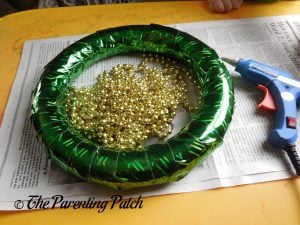 Wrapping the Beads Around the Duct Tape St. Patrick's Day Wreath Craft