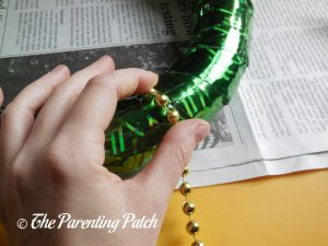 Beads Wrapped Around the Duct Tape St. Patrick's Day Wreath Craft