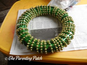 Gluing the Bead Strand to the Duct Tape St. Patrick's Day Wreath Craft