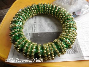 Bead Strand Glued to the Duct Tape St. Patrick's Day Wreath Craft