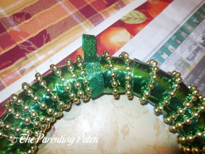 Adding the Ribbon Hanger to the Duct Tape St. Patrick's Day Wreath Craft