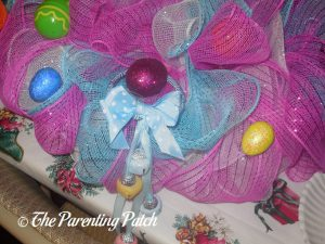 Adding Foam Easter Eggs to the Deco Mesh Easter Wreath