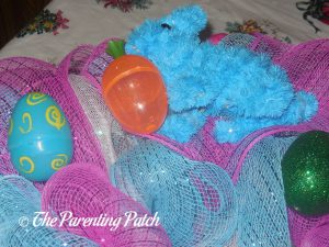 Adding Carrot Eggs to the Deco Mesh Easter Wreath
