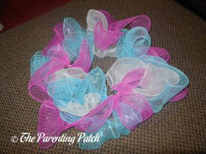 White, Blue, and Pink Loops of Deco Mesh Easter Wreath