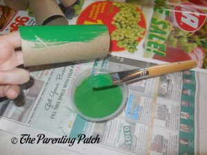 Painting a Toilet Paper Roll Green for the Toilet Paper Roll Leprechaun Hat Craft