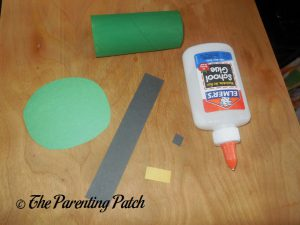 Cutting the Paper Pieces for the Toilet Paper Roll Leprechaun Hat Craft