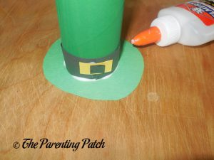 Glue the Green Circle to the Toilet Paper Roll Leprechaun Hat Craft