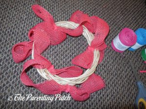 Attaching Coral Burlap Ribbon to the Burlap Ribbon Easter Egg Spring Wreath Craft