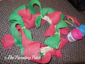 Attaching Green Burlap Ribbon to the Burlap Ribbon Easter Egg Spring Wreath Craft