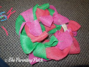 Attaching Pink Burlap Ribbon to the Burlap Ribbon Easter Egg Spring Wreath Craft