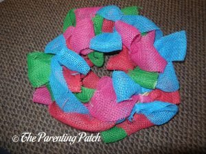 Attaching Blue Burlap Ribbon to the Burlap Ribbon Easter Egg Spring Wreath Craft