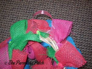 Adding the Ribbon Hanger to the Burlap Ribbon Easter Egg Spring Wreath Craft