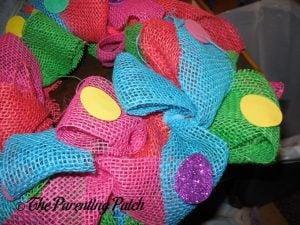 Gluing More Eggs Burlap Ribbon Easter Egg Spring Wreath Craft