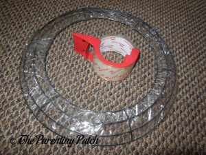 Wire Wreath Wrapped with Clear Tape