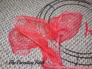 Attaching Red Deco Mesh to the Deco Mesh Patriotic Star Wreath Craft