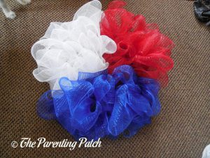 Red, White, and Blue Deco Mesh on the Deco Mesh Patriotic Star Wreath Craft