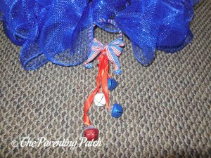 Attaching the Door Hanger to the Deco Mesh Patriotic Star Wreath Craft