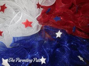 Gluing Glitter Stars to the Deco Mesh Patriotic Star Wreath Craft