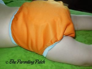 Side of Hook-and-Loop ecoAble Cloth Diaper Cover on 25-Pound Toddler