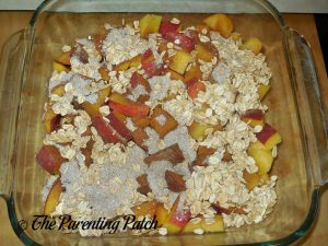 Covering the Peaches with the Oat Mixture for Peach Crisp