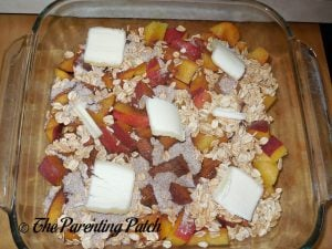 Putting Dollops of Butter on the Peach Crisp