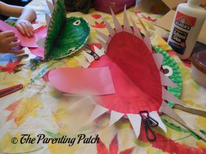 Gluing the Tongue on A Is for Alligator Paper Plate Craft