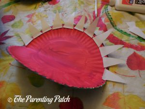 Gluing White Teeth on A Is for Alligator Paper Plate Craft