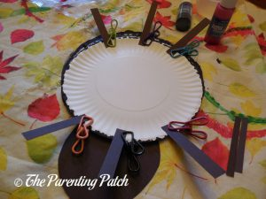 Gluing Together the A Is for Ant Paper Plate Craft