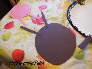 Gluing the A Is for Ant Paper Plate Craft Together